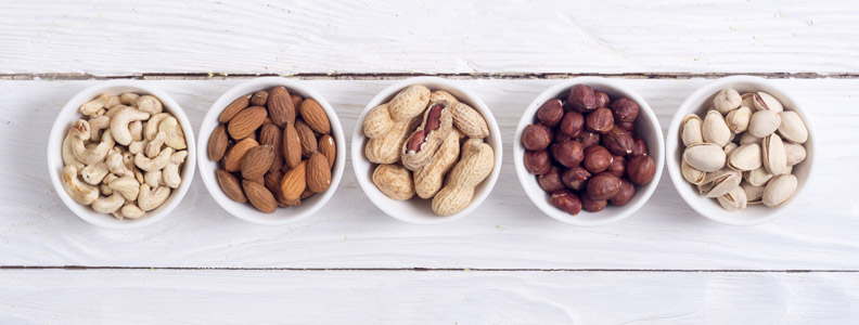 5 bowls of different  types of nuts