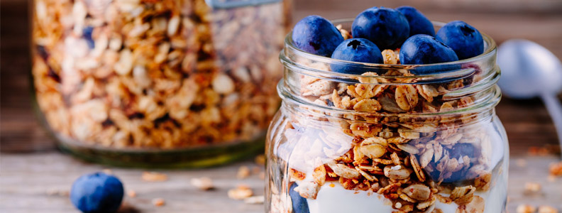 milk, oats, and blueberries in a jar