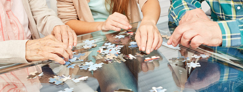 several people putting together a jigsaw puzzle