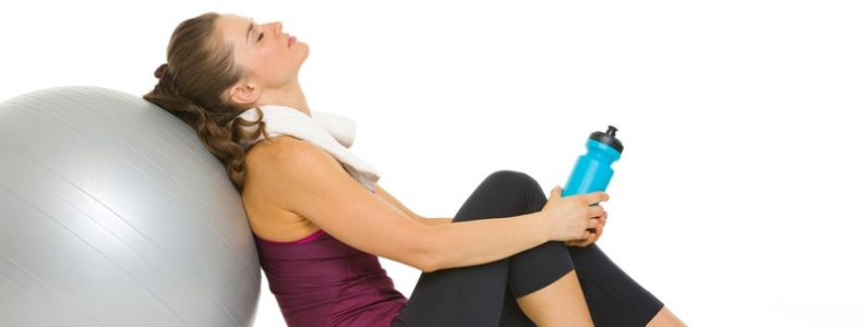 Woman taking a break from working out.
