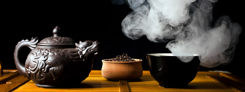 teapot, teacup, and steam