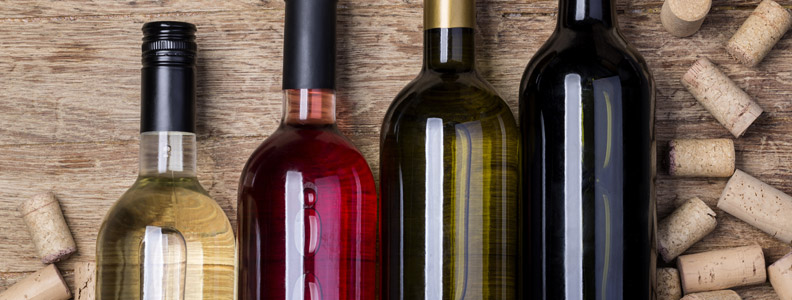 Four bottles of various types of wine.