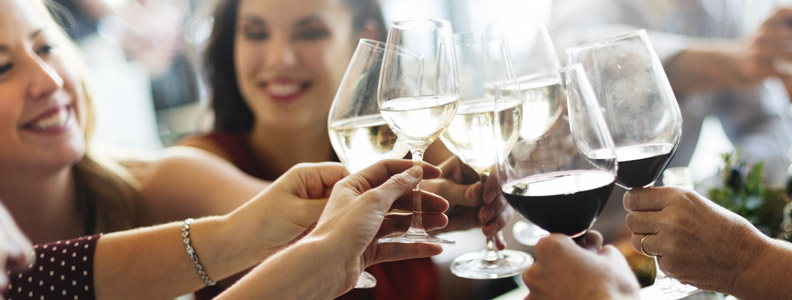 people toasting with a glass of wine