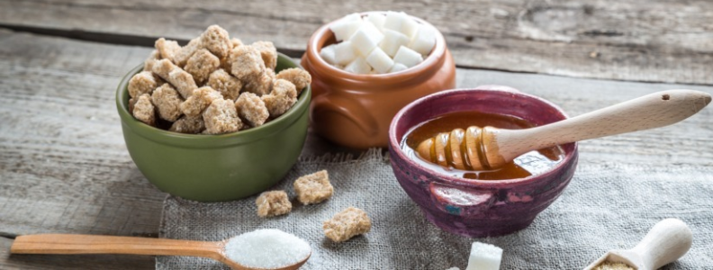 3 white sugar replacements including honey, natural cane sugar, and sucralose