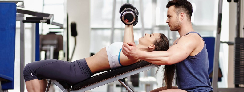Strength training like lifting weights is an important part of preparing for running a marathon.