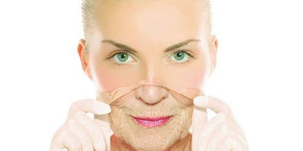 woman peeling off a mask of perfect young skin to reveal an old woman's face beneath