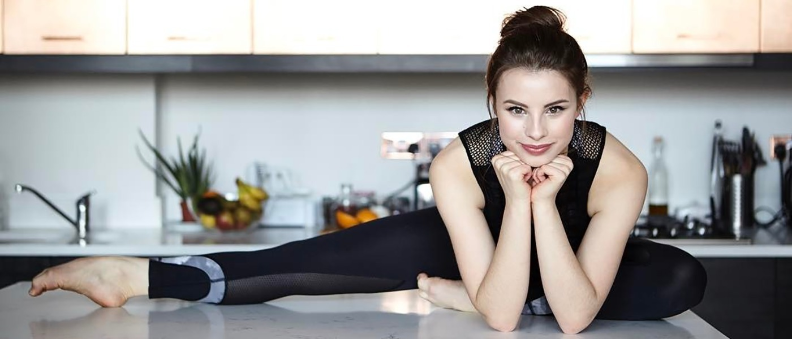 woman stretching on countertop