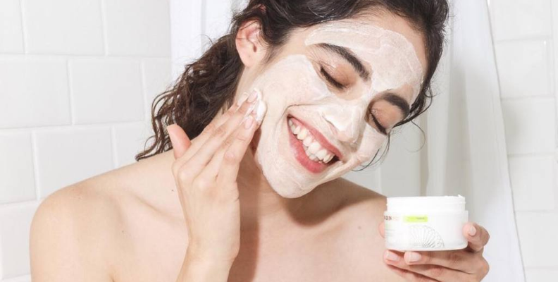 woman putting skin cream on her face