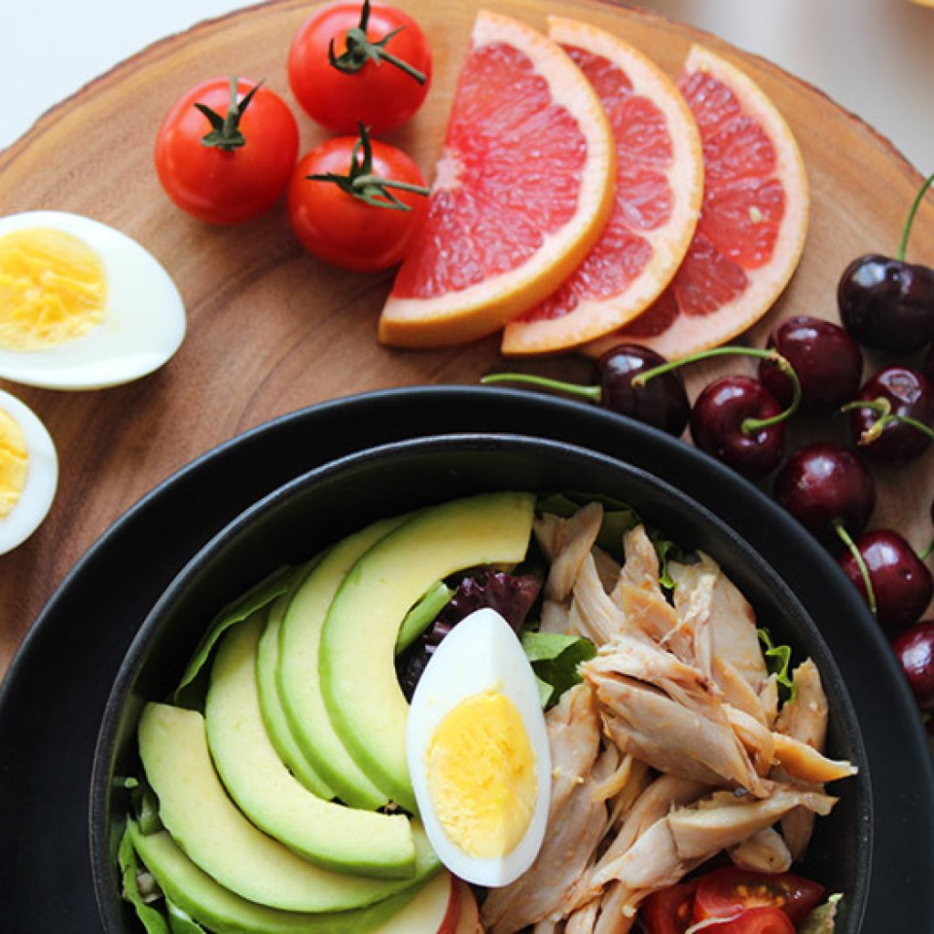 A salad with a variety of fruits and vegetables makes up a healthy diet.