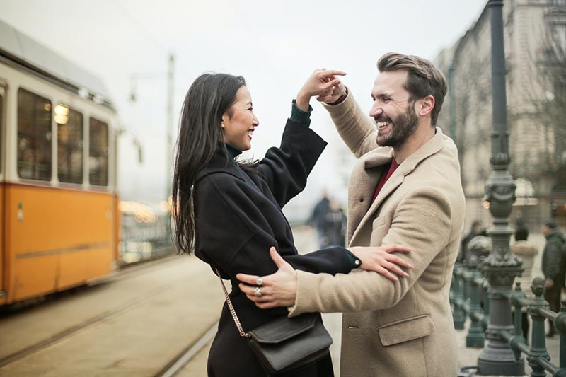 Man and woman dancing in the street.