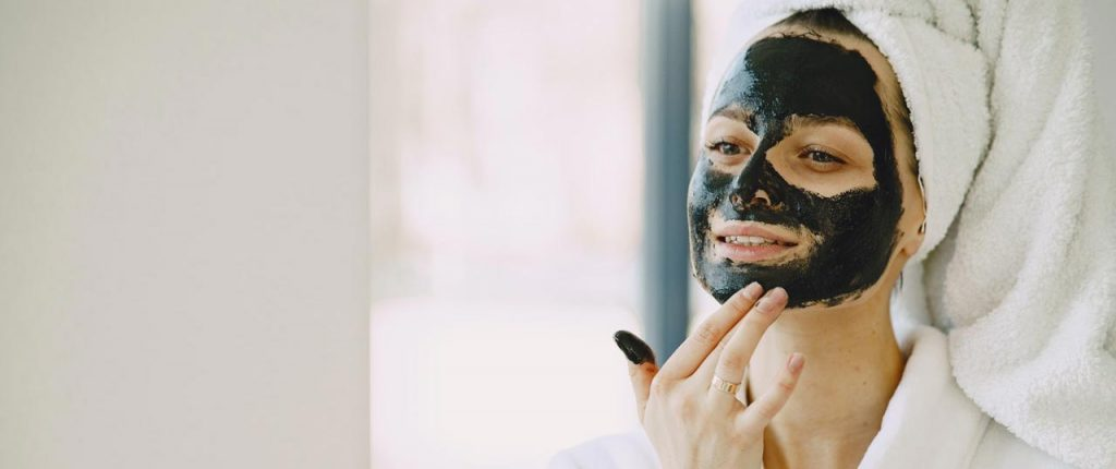 Woman with black facial mask