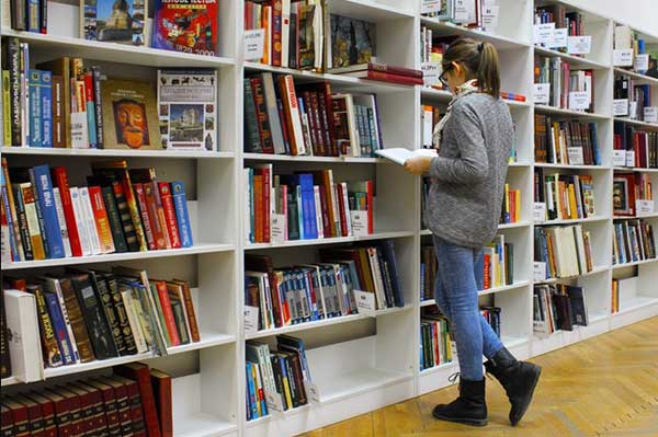 girl-standing-while-reading-book